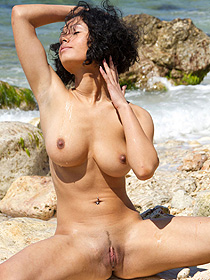 Busty Girl Strips By The Sea