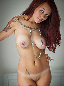 Tattooed Redhead Hottie Strips