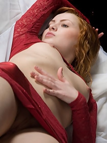 Sexy redhead in her bed