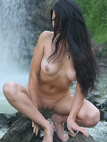 Busty Chick Is Nude By The Waterfall