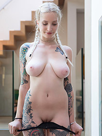 Busty Tattooed Swann